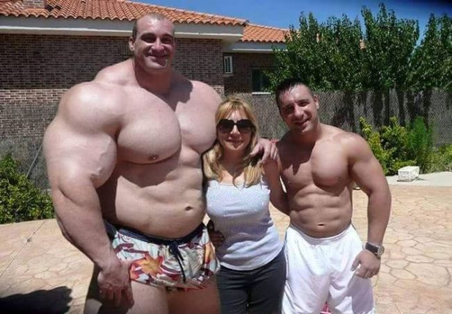 massive body builder makes normal people look tiny