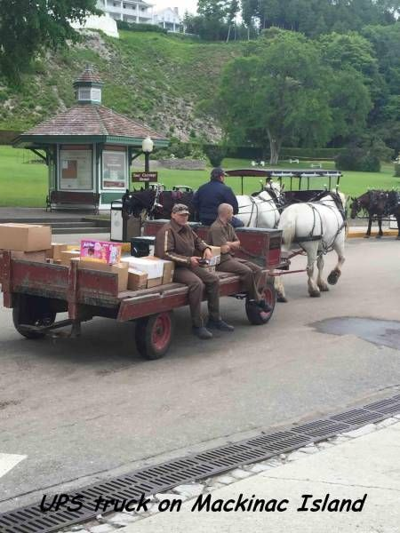 ups truck on mackinac island, horse drawn carriage