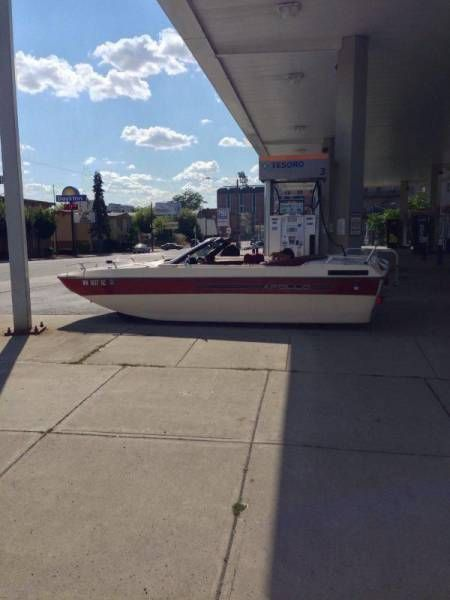 when gas prices at the marina are just ridiculous, boat at gas pump