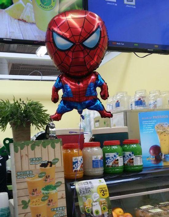 giant headed spiderman balloon held down by penis