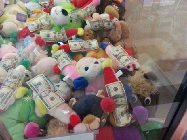 money and stuffed animals in the claw machine