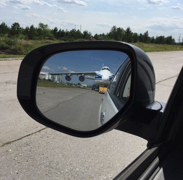 when you look in the rear view mirror and think you should probable yield, passenger plane on road