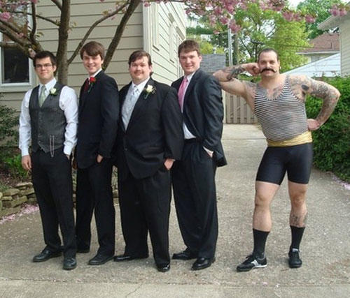 awkward prom photo, muscular guy in tight french getup, wtf