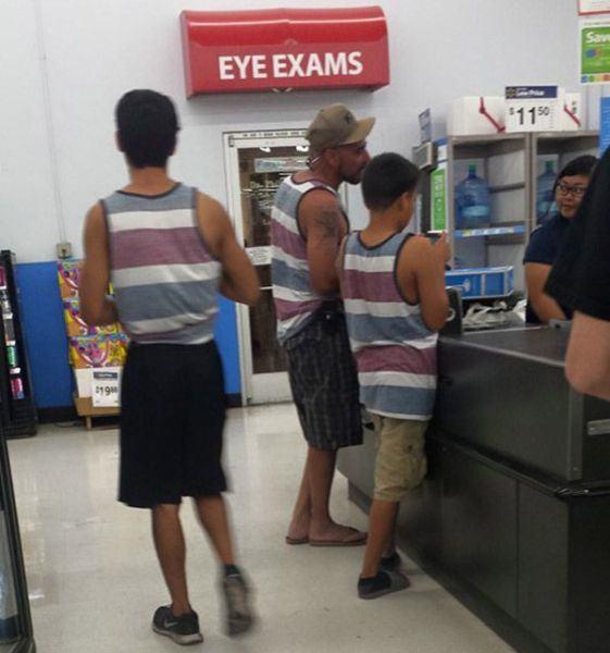 three guys wearing the same shirt need eye exams