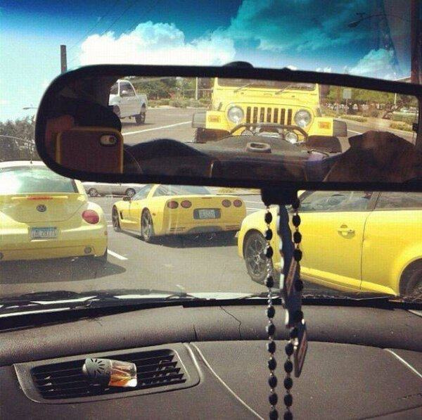 when you are completely surrounded by black and yellow, four yellow cars circling driver in car