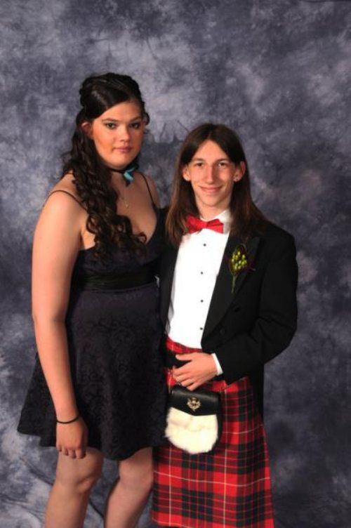 awkward prom photo of big girl and small scotsman