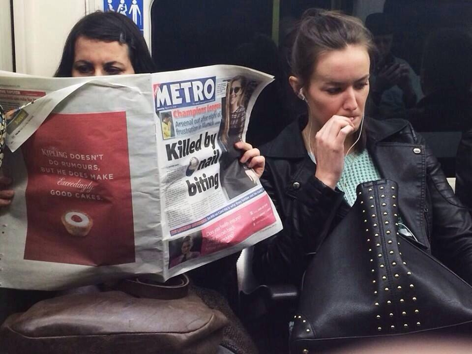 girl biting nails next to woman reading the newspaper with the headline killed by nail biting