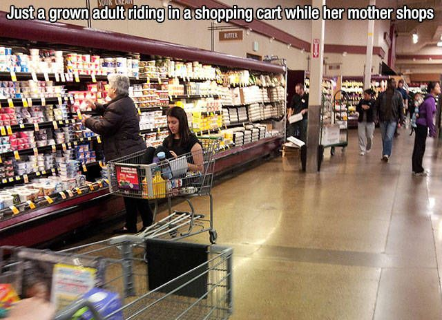 just a grown adult riding in a shopping cart while her mother shops, wtf