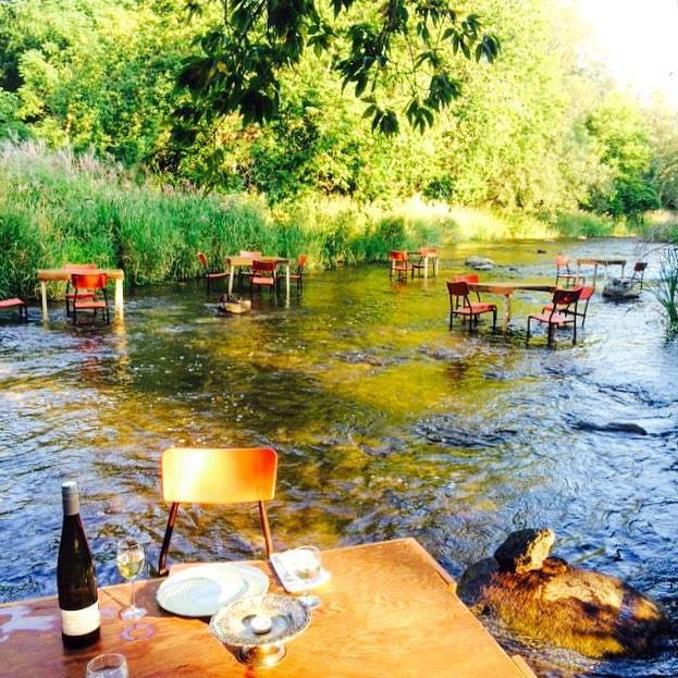 river cafe, tables and chairs in a river bed