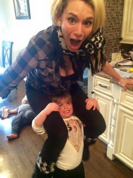 little kid lifting mother, parenting fun