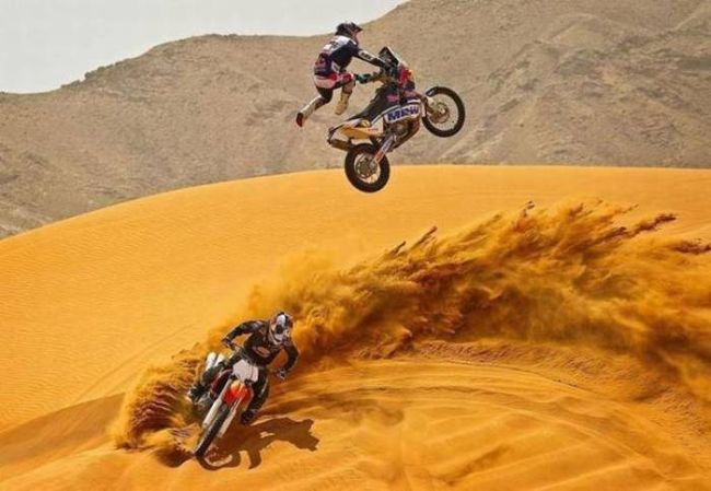 just two guys having fun with dirt bikes
