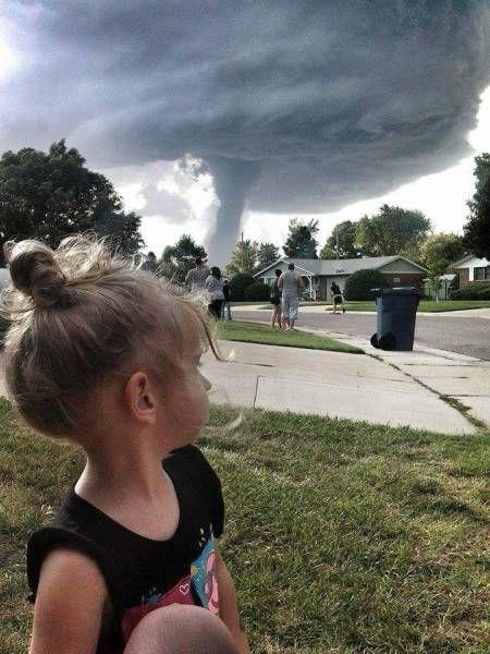 tornado coming down from a menacing cloud