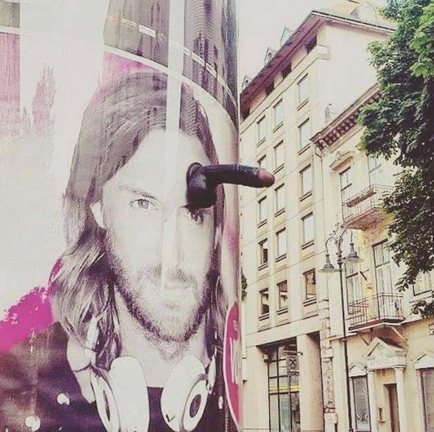 jesus with a dildo on his head street art, wtf
