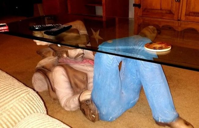 sleeping cowboy supported glass coffee table