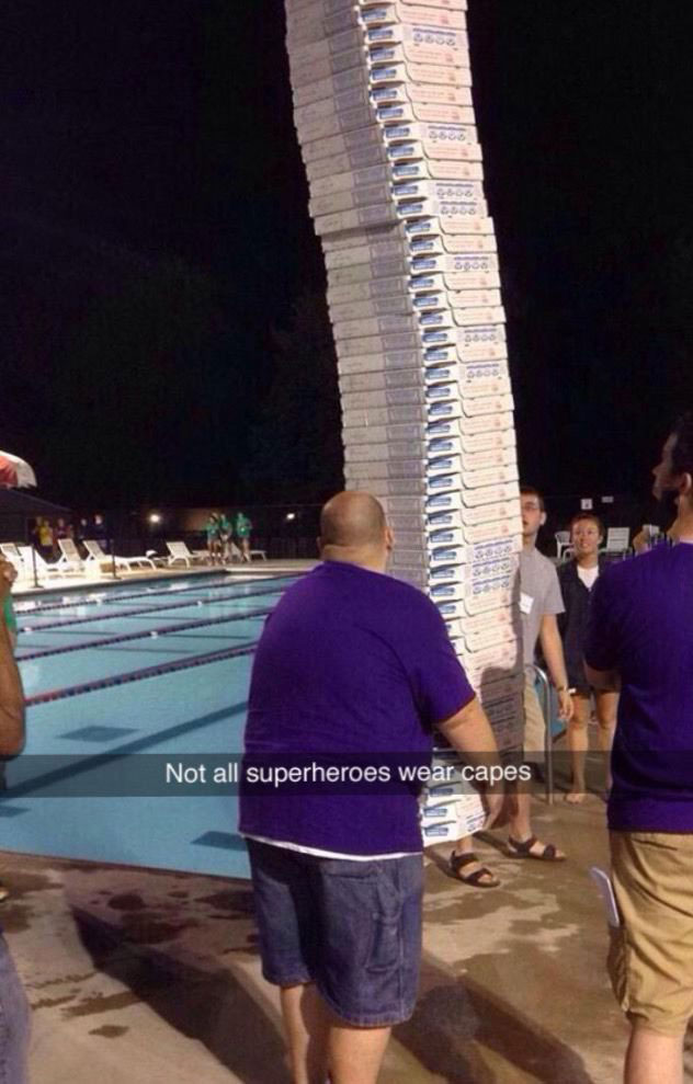 not all superheroes wear capes, man walking with epic stack of pizzas