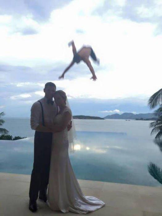 best wedding photobomb ever, married couple and guy falling from the sky into the water