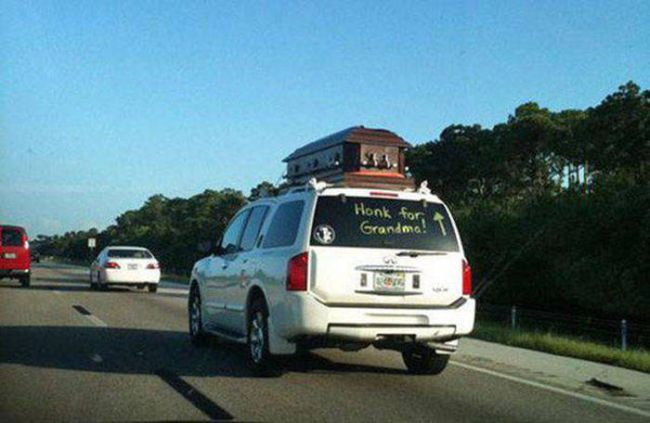 honk for grandma, coffin on roof of suv on the highway, wtf