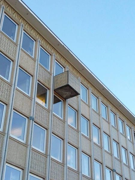 must be a glitch in the matrix, box jetting out of the side of a building