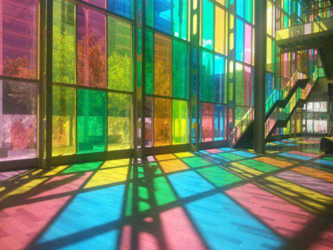 stained glass full height windows make for a colourful interior during the day