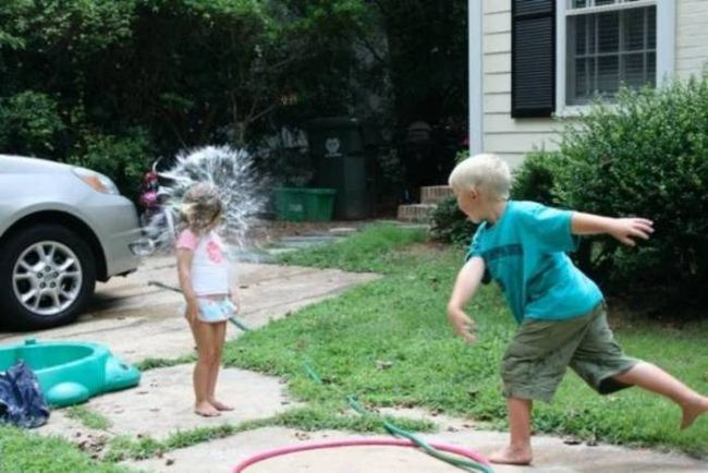 perfectly timed water balloon explosion, siblings have a water fight
