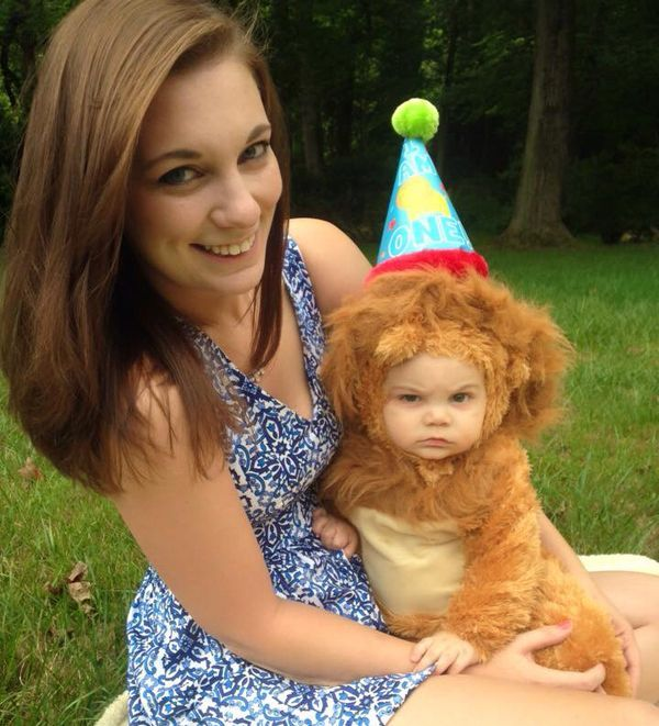 baby in lion costume looking annoyed, cute