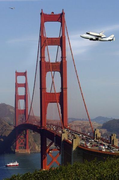 space shuttle being flown closer to space by a 747 over the golden gate bridge