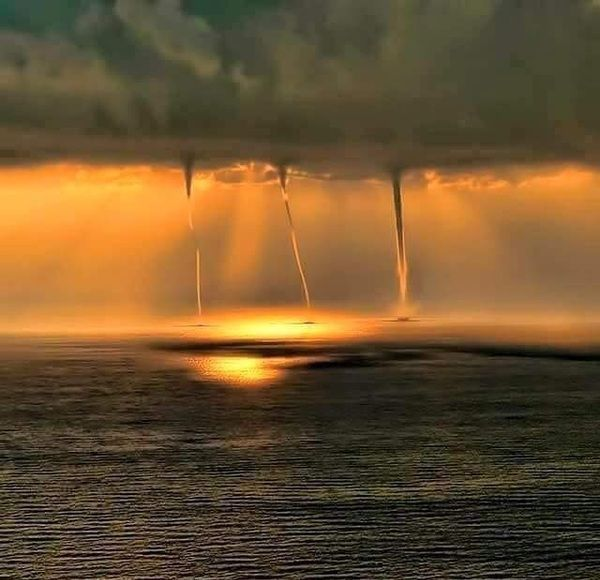triple waterspout in the sunset