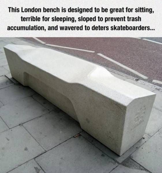 this london bench is designed to be great for sitting, terrible for sleeping, sloped to prevent trash accumulation and wavered to deter skateboarders