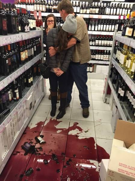 the girl who didn't need a shame sign, broken bottle of red wine in alcohol store