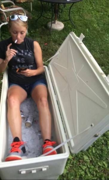 how to really chill out, girl sitting in a beer cooler full of ice and beer