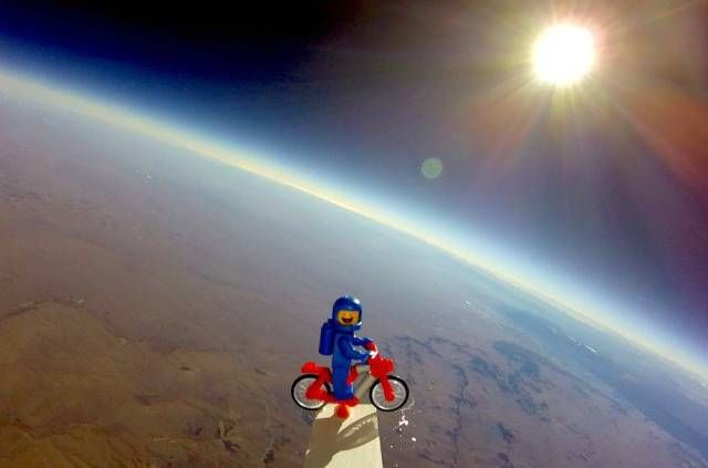 motorcycling lego at the edge of space, epic