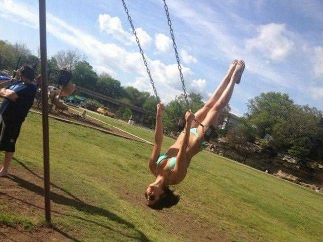 swinging in a blue bikini, upside down, blue skies