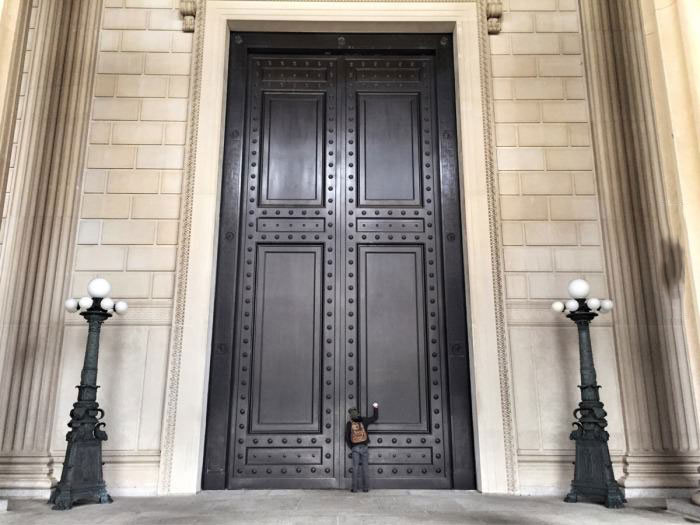 giant doors with a person to scale