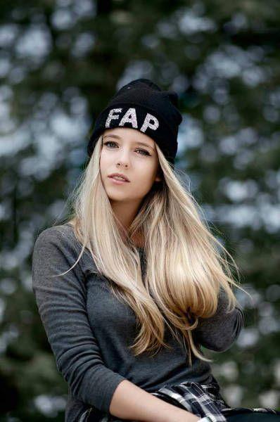 girl wearing a fap hat