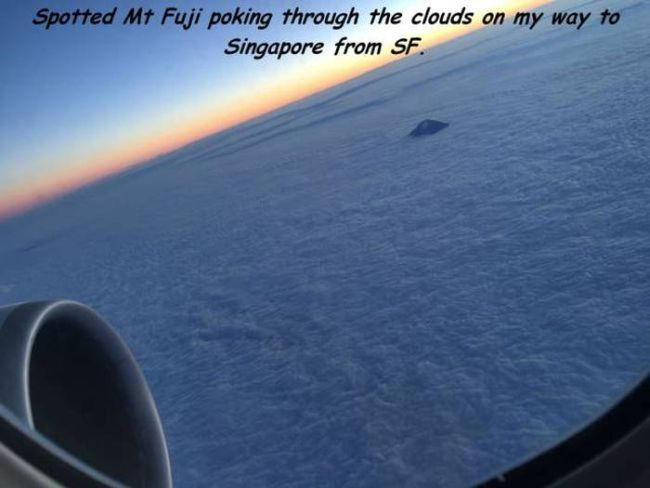 spotted mt fuji through the clouds on my way to singapore from sf