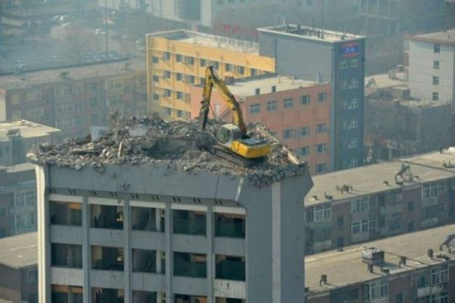 bulldozer on top of high building, this won't end well