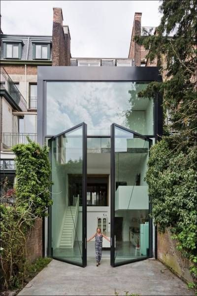 giant glass doors in back of house, epic architecture
