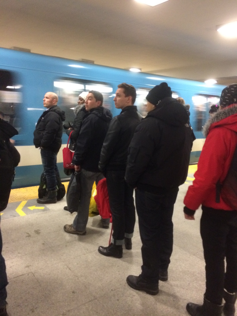 people lining up single file for the metro, only in canada