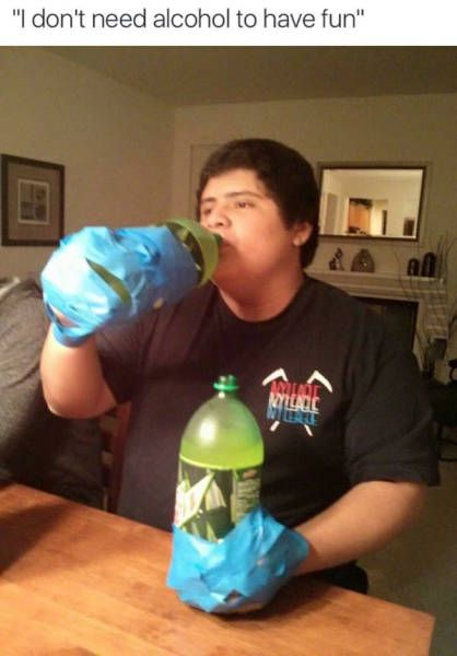i don't need alcohol to have fun, two 2l mountain dew bottles taped to hands