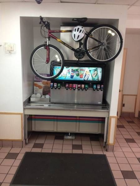bicycle stored above beverage machine, wtf