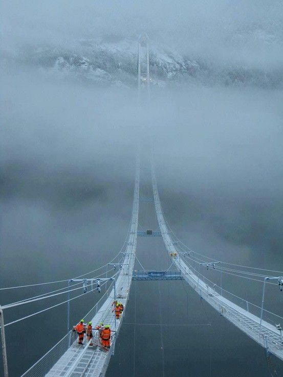 ridiculously scary wire bridge between mountains