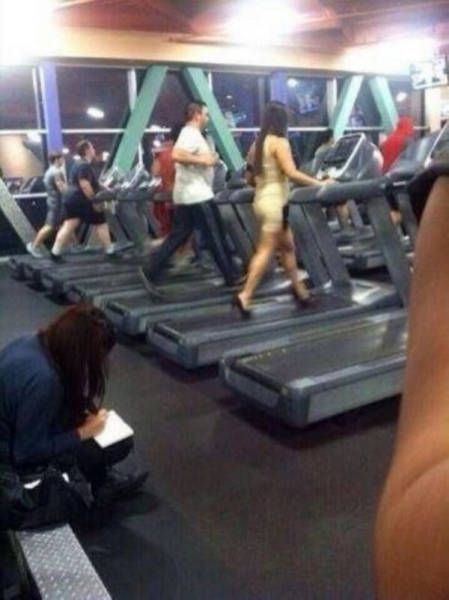 when you go to a really classy gym, woman working out in tight dress