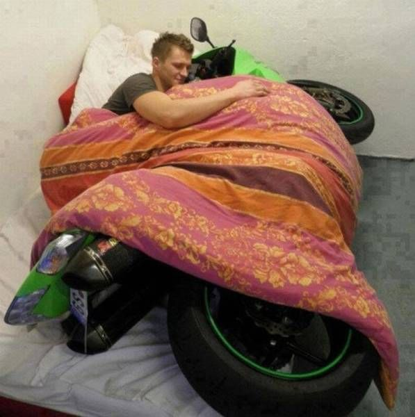 cuddling with your favourite one, motorcycle in bed