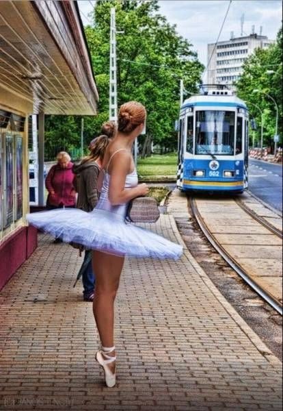 ballerina waiting for the train on her tip toes