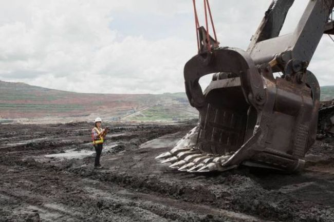 ridiculously big excavator in the tar sands