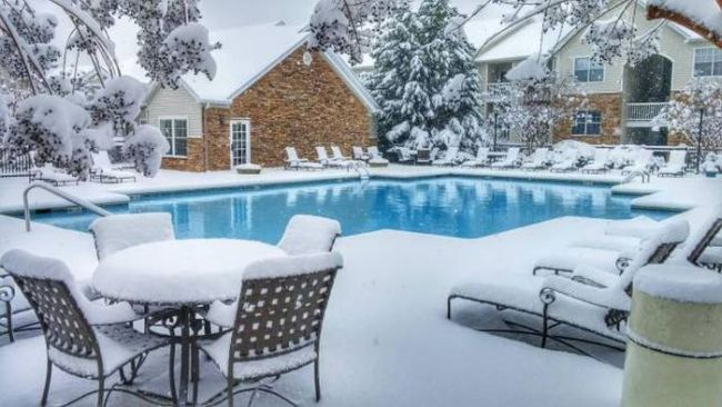 inviting outdoor in ground swimming pool in the winter