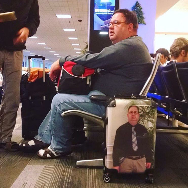 fat guy has picture of self on luggage