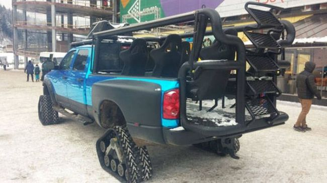 snowbound pick up truck with tank wheels
