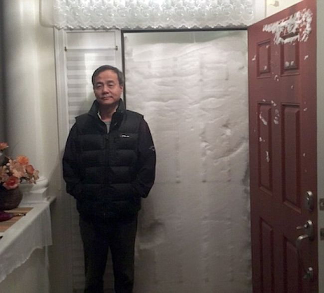when it snowed a little bit too much, door open to wall of snow