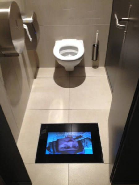 best bathroom ever, tv screen in floor below toilet